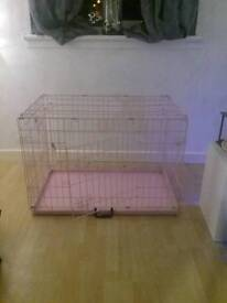 Dog cage in pink