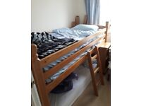 Antique pine mid-sleeper cabin bed with pull out desk and under storage cupboard