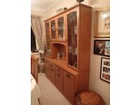 Display unit with glass shelves, lights, cupboards and drawers