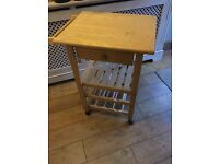 Wooden butchers block with drawer , towel rail . Wheeled wine rack