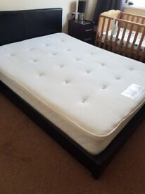 King size faux leather bed.