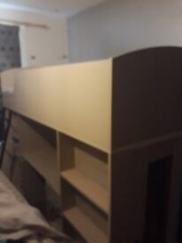 Wooden cabin bed with new materess has pull out desk, wardrobe, shelves and drawers