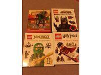 4 Lego books with mini figures.
