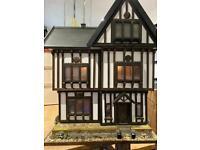 Beautiful hand made wooden Tudor dolls house