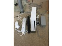 Nintendo Wii, with Wii controller, 2 compatible gamecube controllers, 4 games