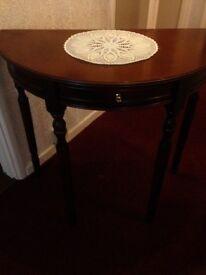 Half round Mahogony table