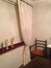 Beautiful cream silk curtains. Four panels