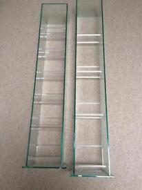 Two glass CD and DVD tower racks