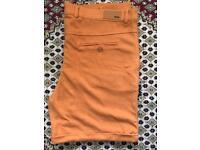 New men's orange Fendi shorts