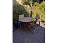 Four folding patio chairs and table