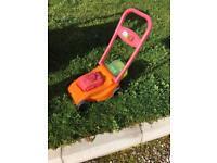 Child's lawnmower garden toy