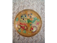 Cute round wooden trinket box –illustration of kitsch colourful rabbit & cat (?) riding bike on lid.