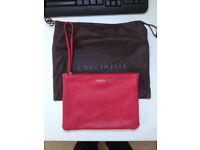 Coccinelle leather clutch bag in original cloth bag.