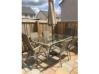 6 seater garden dining table with parasol