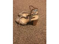Gold and silver wedge heels