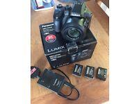 Panasonic Lumix FZ330 12.1MP digital bridge camera with 2 spare batteries.