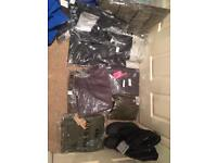 Job lot of winter jackets and winter jeans with arctic boots