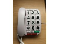 Corded telephone with large push buttons