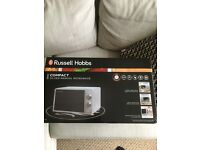 BRAND NEW, NOT EVEN BEEN OPENED, RUSSELL HOBBS COMPACT MICROWAVE RHMM703S