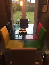 Excellent 6'glass family dining table with 2 black 2white and 4 leather seats variety colours