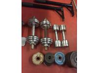 Weight plates. Dumbbell barbell bars. Olympic bars. dumbbell set & more