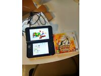 Boxed Nintendo 3DS XL (red) with Pokemon Sun & Super Mario Bros