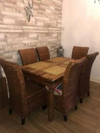 Wooden dining table and 6 rattan chairs