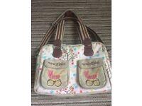 Yummy mummy's pink lining changing bag