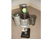Juicer..hardly used..includes instruction book.