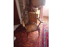 Pair of ercol carver chairs in a dark oak colour