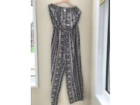 Brand new with tags . Jumpsuit