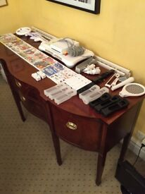 Nintendo Wii, with multiple games, nunchucks, controllers and skins