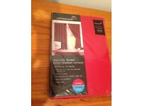 Brand New Red blackout eyelet curtains +Tie-Backs - each curtain is W168cm x L137cm -Still Packaged