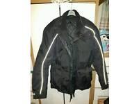 Motorbike jacket fits L/XL (no make on it)