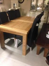 Ext oak table £390 ,black leather chairs,bow on the back £80 each