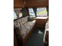 2 berth lightweight lunar stellar caravan, motor mover and full awning. Ready to hook up and go!