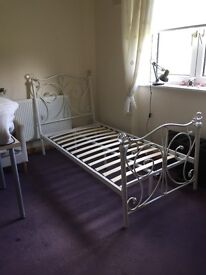 Single white metal bed with crystal finials