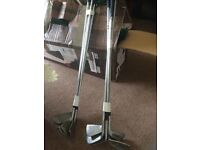 10 Various golf clubs