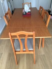 Teak Extending Dining Table with 6 matching chairs