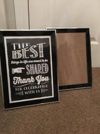Two black and silver photo frames