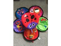 Lamaze spin and explore tummy time play mat