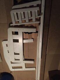 Toddler bed frame in white.