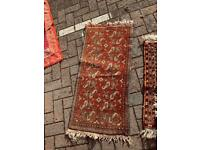 Small floral Persian rug