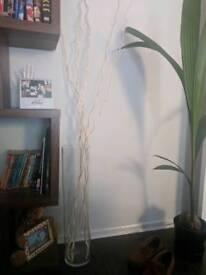 Tall vase with decorative sticks