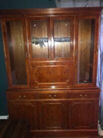 Polished Oak storage cabinet with glass shelving