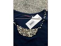 Sleeveless bead insert top