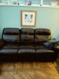 Black leather three piece sofa, reclining chairs