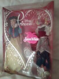 Little girls NEW, Genuine Disney 'Snow White' Doll plus a set of 'Barbie' Doll cloths