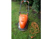 FLYMO LAWNMOWER WITH GRASS COLLECTION BOX AND LONG ELECTRIC LEAD ONLY £20 CAN BEE SEEN WORKING