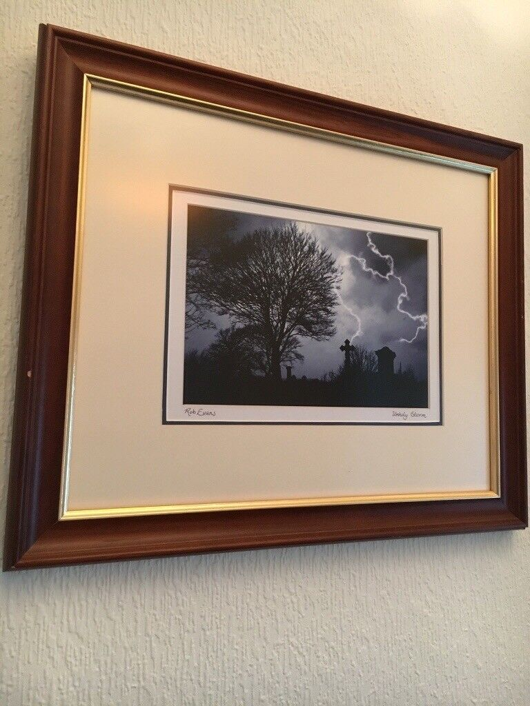 Print of thunder storm and landscape